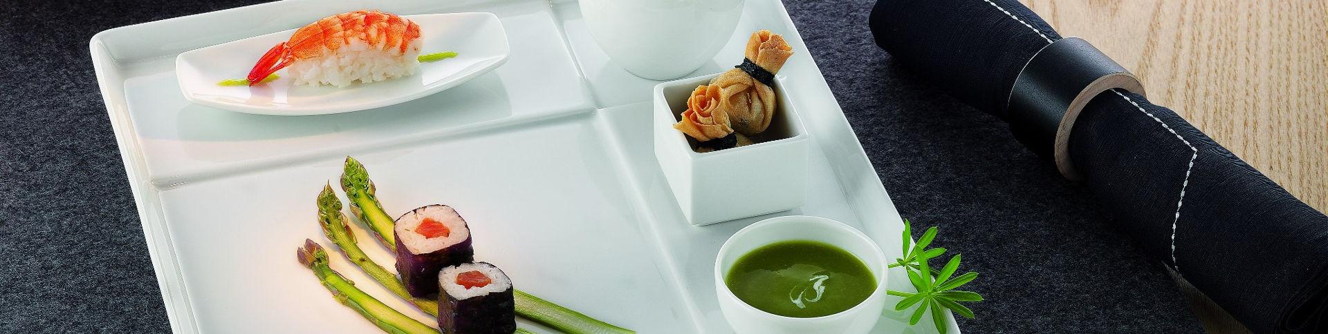 Hauptslider mit hübsch angerichtetem Sushi-Menü auf ästhetischem Prozellan